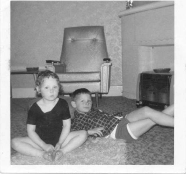 Donna in leotard with older brother